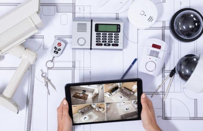 person-monitoring-smart-house-on-digital-tablet-picture-id1125366038-1030x488